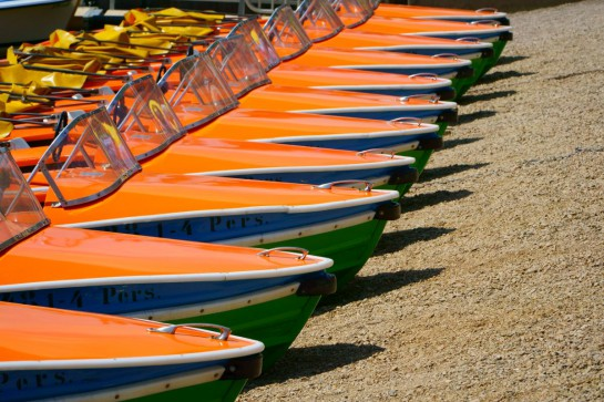 Pedal boats in a row at the shore